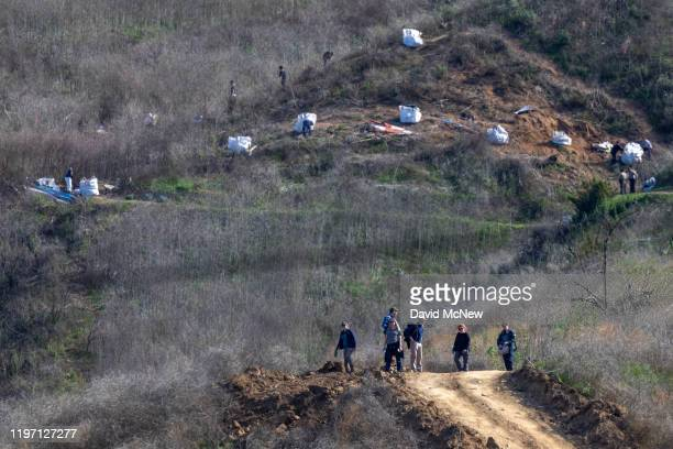 Investigators work at the scene of the helicopter crash where former NBA star Kobe Bryant and his 13yearold daughter Gianna died on January 28 2020...