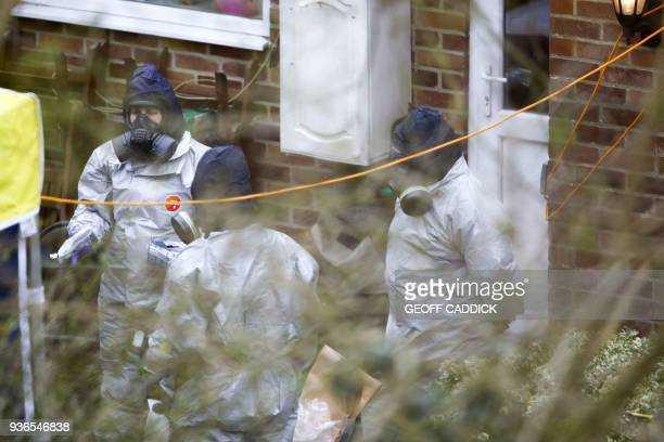 Investigators work in the garden of Sergei Skripal's house in Salisbury southern England on March 22 as investigations and operations continue in...