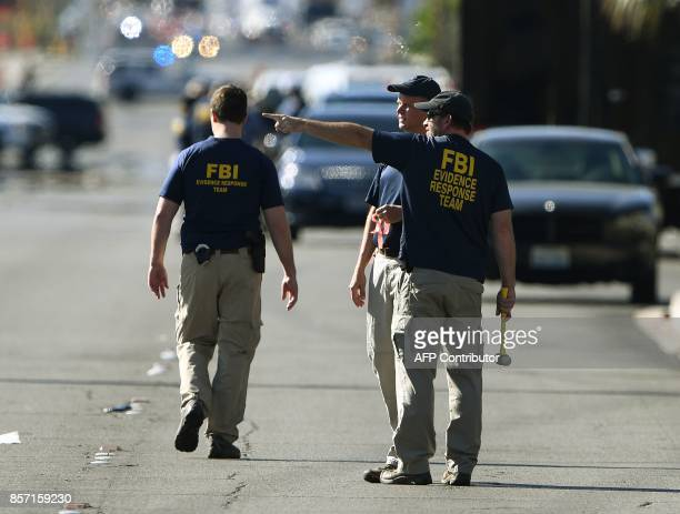 FBI investigators work outside the Route 91 festival venue after a gunman killed more than 50 people and wounded more than 200 others when he opened...