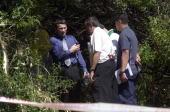 Investigators work the scene where Phil Murray fou