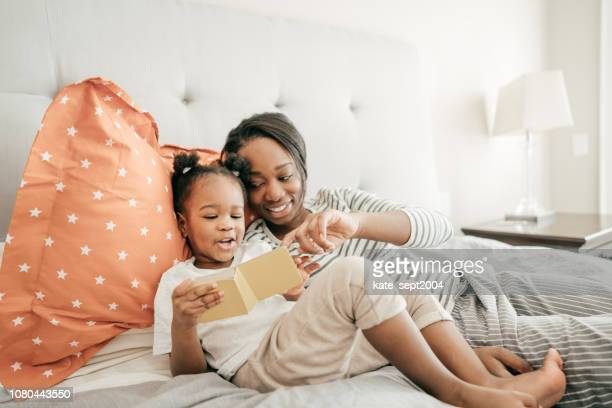investing in the education of your child - black mothers day stock pictures, royalty-free photos & images