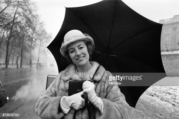 Investitures at Buckingham Palace Vera Lynn leaves carrying her OBE 11th February 1969