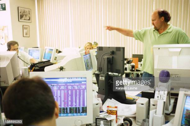Investment advisor Jim Cramer talks to employees at the offices of TheStreetcom on August 25 1998 in New York City New York