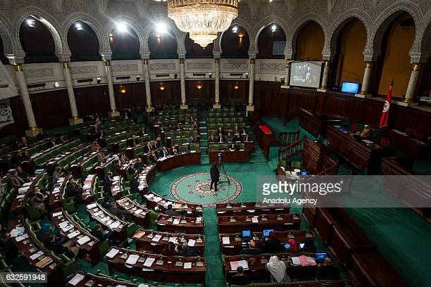 Investment and Development Minister of Tunisia Fadel AbdulKafi delivers a speech on decreasing of poverty rate at parliament building in Tunis...