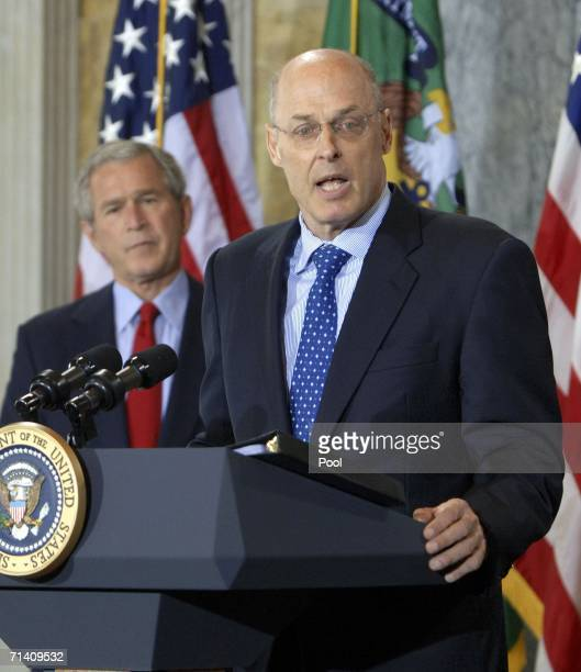 Investment banker Henry Paulson speaks after being sworn in by Chief Justice John Roberts as US President George W Bush looks on during a ceremony at...