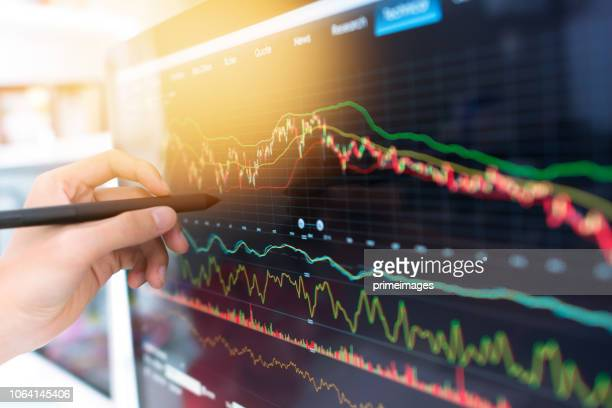 investment theme stockmarket and finance business analysis stockmarket with digital tablet - economia foto e immagini stock