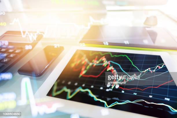 investment theme stockmarket and finance business analysis stockmarket with digital tablet - forex trading stock pictures, royalty-free photos & images