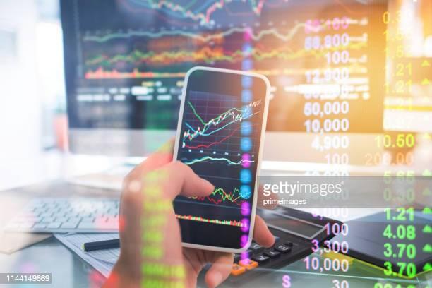 investment theme stockmarket and finance business analysis stockmarket with digital tablet - zinssatz stock-fotos und bilder