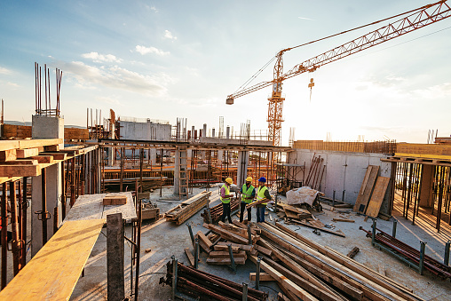 Investors and contractors on construction site 1042342584
