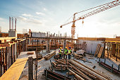 Investors and contractors on construction site