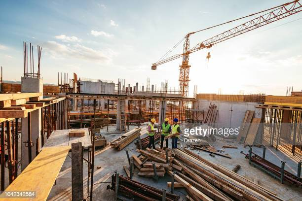 investors and contractors on construction site - built structure stock pictures, royalty-free photos & images