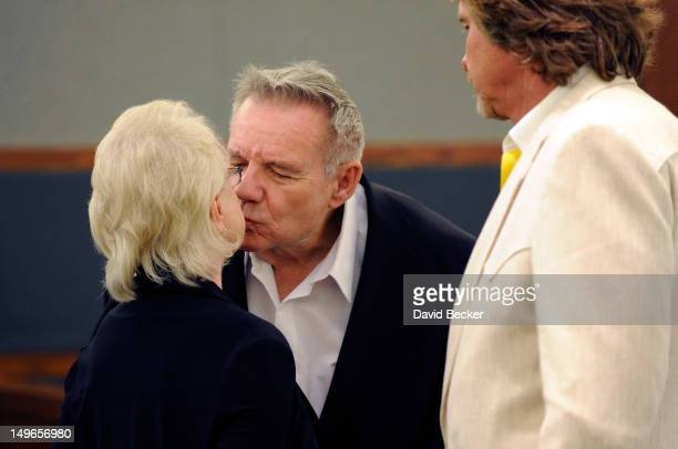Investors Dorothy Harber and Lacy Harber kiss while developer Steve Kennedy looks on during a court recess at the Clark County Regional Justice...
