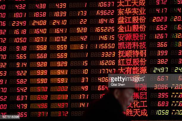Investors monitor prices and make trades at a securities exchange house in Shanghai China on 30 December 2011 China's A shares had the biggest drop...