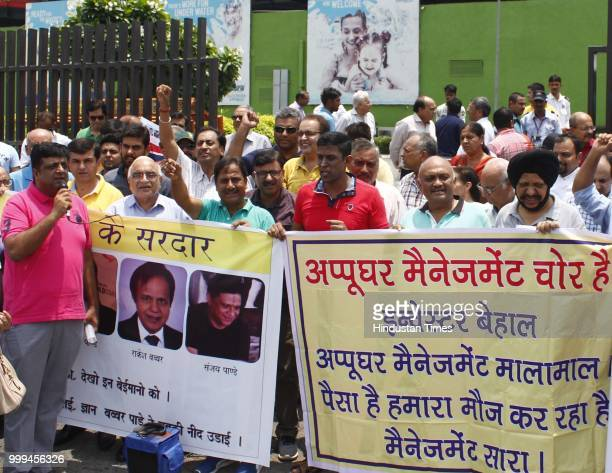Investors protest against the Appu Ghar water park management inside the water park due to delay in possession of shops on July 15 2018 in Gurugram...