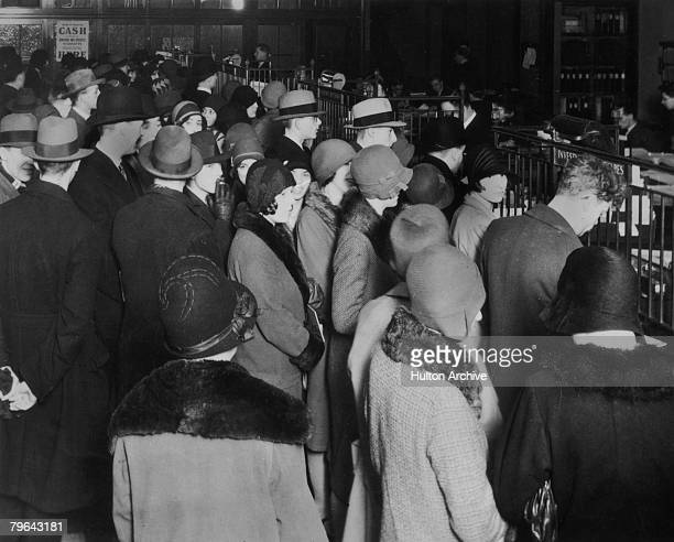 Investors rush to withdraw their savings during a stock market crash circa 1929
