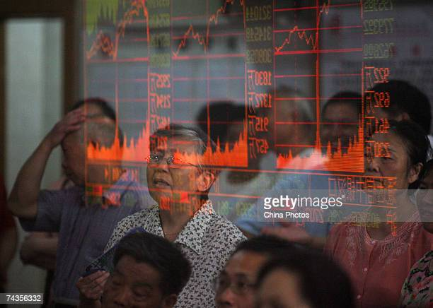 Investors view the stock index on an electronic screen at a securities company on May 30 2007 in Wuhan of Hubei Province China The Shanghai Composite...