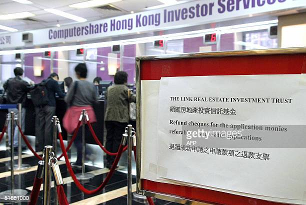 Investors wait at windows for refund cheques to get back application money following the government's annoucement the evening before it would scrap a...