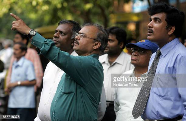 BSE Investors watch the rising Sensex outside the Bombay Stock Exchange that eventually stopped short of 18000