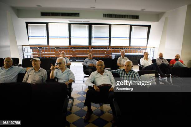Investors watch trading screens at the Amman Stock Exchange at the Housing Bank Complex in Amman Jordan on Thursday June 21 2018 President Trump and...