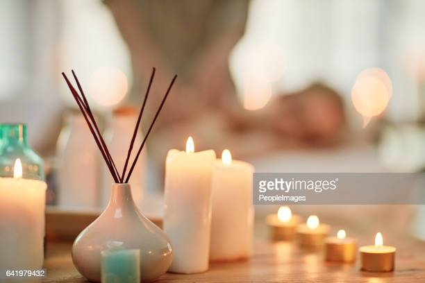 invigorate your senses with a day at the spa - candle stock pictures, royalty-free photos & images