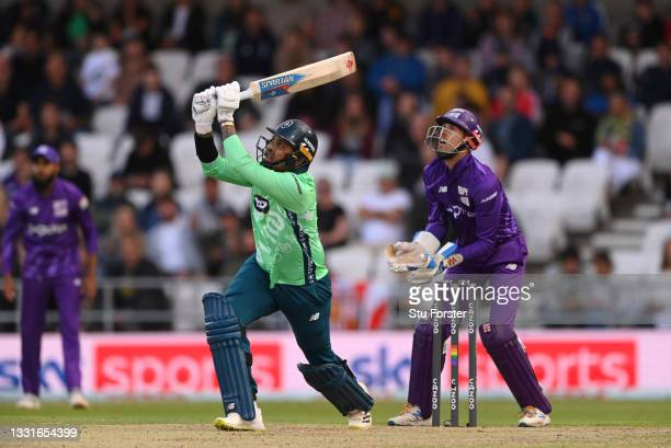 Invincibles batter Sunil Narine hits out only to be caught on the boundary watched by John Simpson during The Hundred match between Northern...