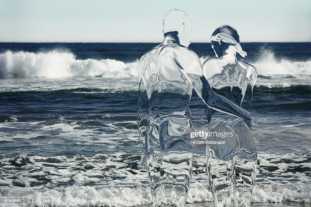 Invisible couple on the beach : Stock Photo