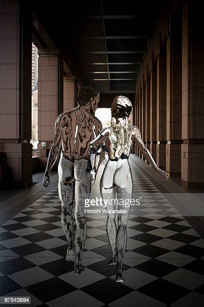 Invisible couple walking along a corridor