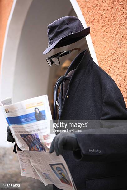 Invisible man reading a newspaper