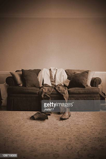 Invisible Man Sitting in Empty Room