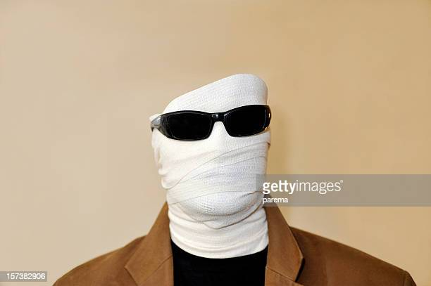 Invisible man with white bandaged face and sunglasses