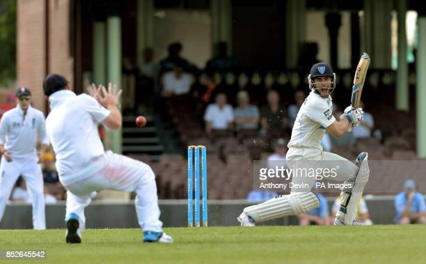 CA Invitational XI's Ryan Carters hits a boundary past England's Ian Bell during an international match at the Sydney Cricket Ground Sydney