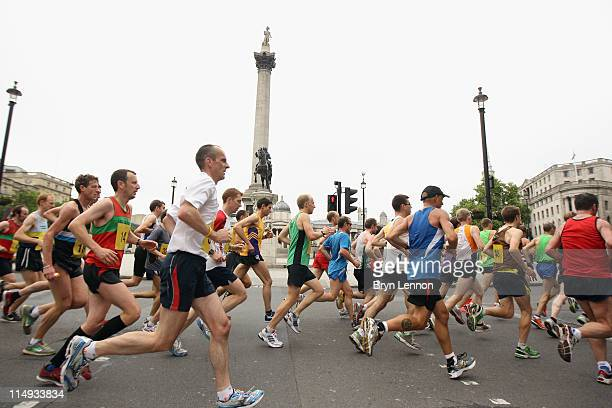 50 invited club runners make their way past Nelson's Column on the LOCOG 2012 Test Event for the London 2012 Olympic Marathon at Tralgar Square on...