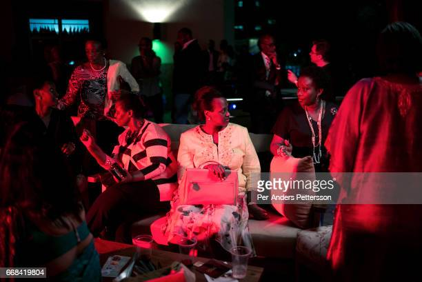 Invited guests in a VIP bar between fashion show at Kampala Fashion Week on the rooftop of the Acacia Mall Kampala Uganda on November 12 2015