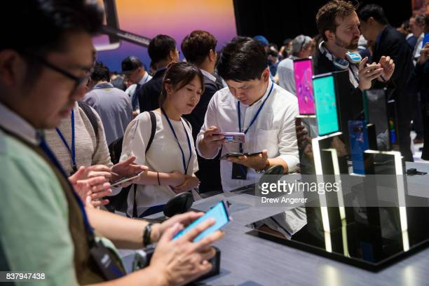 Invited guests try out and examine the new Samsung Galaxy Note8 smartphone during a launch event August 23 2017 in New York City The Galaxy Note8...