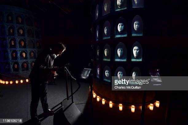 Invited guests use an interactive display which allows their face to be displayed alongside cast members at the Game Of Thrones: The Touring...