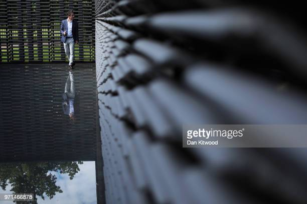 Invited guests walk around the Summer Pavilion at The Serpentine Gallery on June 11 2018 in London England The new pavilion was designed by Mexican...