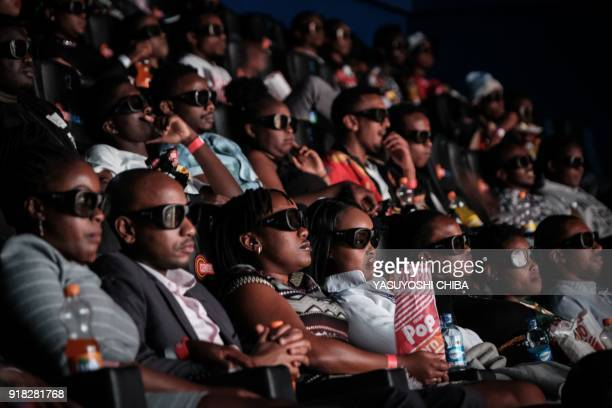 Invited guests watch the film 'Black Panther' in 3D which featuring Oscarwinning Mexico born Kenyan actress Lupita Nyongo during Movie Jabbers Black...