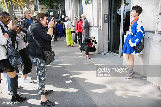 PARIS Invitees wait outside ahead of Chinese designer Masha Ma's show at the Monica Bismarck American Center on 4th October 2015 Outside less...