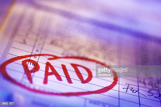 invoice marked paid - paid stock pictures, royalty-free photos & images