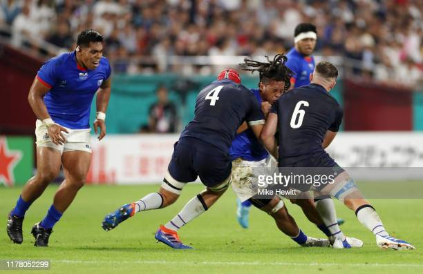 Ioane of Samoa is tackled by Grant Gilchrist and Magnus Bradbury of Scotland during the Rugby World Cup 2019 Group A game between Scotland and Samoa...