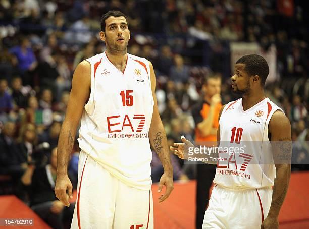 Ioannis Bourousis #15 of EA7 Emporio Armani Milan and Omar Cook #10 of EA7 Emporio Armani Milan during the 20122013 Turkish Airlines Euroleague...