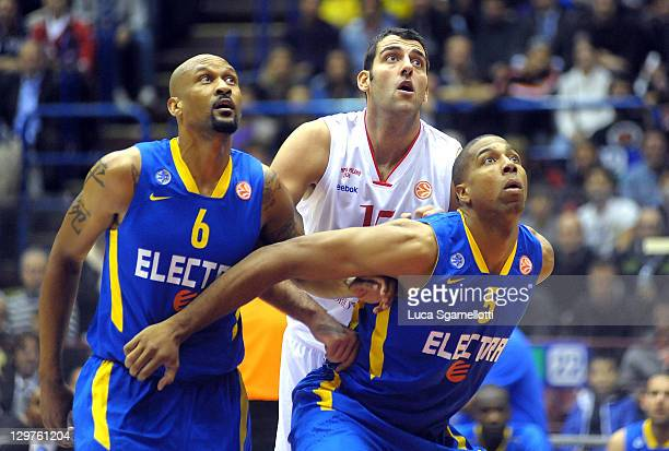 Ioannis Bourousis #15 of EA7 Emporio Armani Milan competes with Devin Smith #6 and Richard Hendrix #5 of Maccabi Electra Tel Aviv during the 20112012...