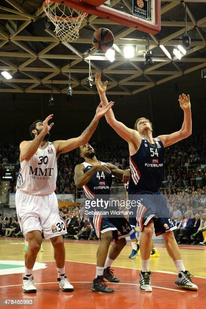 Ioannis Bourousis #30 of Real Madrid competes with Bryce Taylor #44 and John Bryant #54 of FC Bayern Munich during the 20132014 Turkish Airlines...