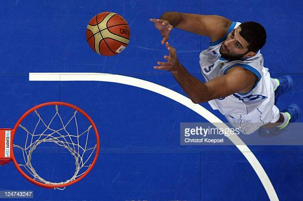 Ioannis Bourousis of Greece dunks the ball during the EuroBasket 2011 second round group F match between Greece and Georgia at Siemens Arena on...