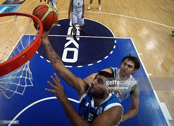 Ioannis Bourousis of Greece scores against Erazem Lorbek of Slovenia during the EuroBasket 2011 second round match between Slovenia and Greece at...