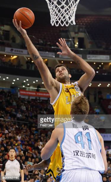 Ioannis Bourousis of Guang Sha and Justin Hamilton of Beijing Ducks in action during the 2017/2018 CBA League match between Beijing Duck and Guang...