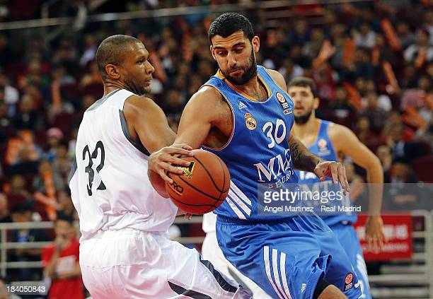 Ioannis Bourousis of Real Madrid drives against Randolph Morris of Beijing Ducks during the Euroleague Basketball China Tour 2013 game at MasterCard...