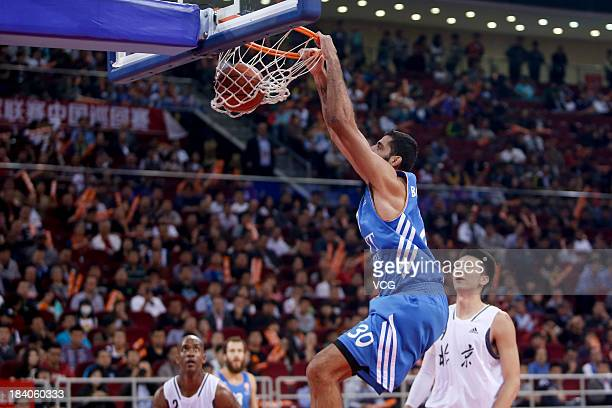 Ioannis Bourousis of Real Madrid dunks uring the Euroleague Basketball China Tour 2013 game against Beijing Ducks at MasterCard Center at MasterCard...