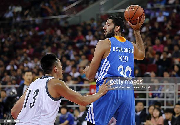 Ioannis Bourousis of Real Madrid searching for a pass under pressure by Zhu Yanxi of Beijing Ducks during the Euroleague Basketball China Tour 2013...