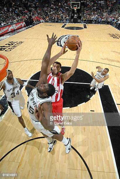 Ioannis Bourousis of the Greece Olympiacos puts up a shot against DeJuan Blair of the San Antonio Spurs during the exhibition game on October 9 2009...
